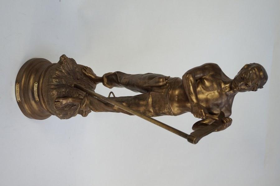 ROUSSEAU, d'après. Le Faucheur. Ronde-bosse en régule dorée signée ROUSSEAU sous la terrasse. Fonte d'édition ultérieure. Années 1920. H. 66 cm.