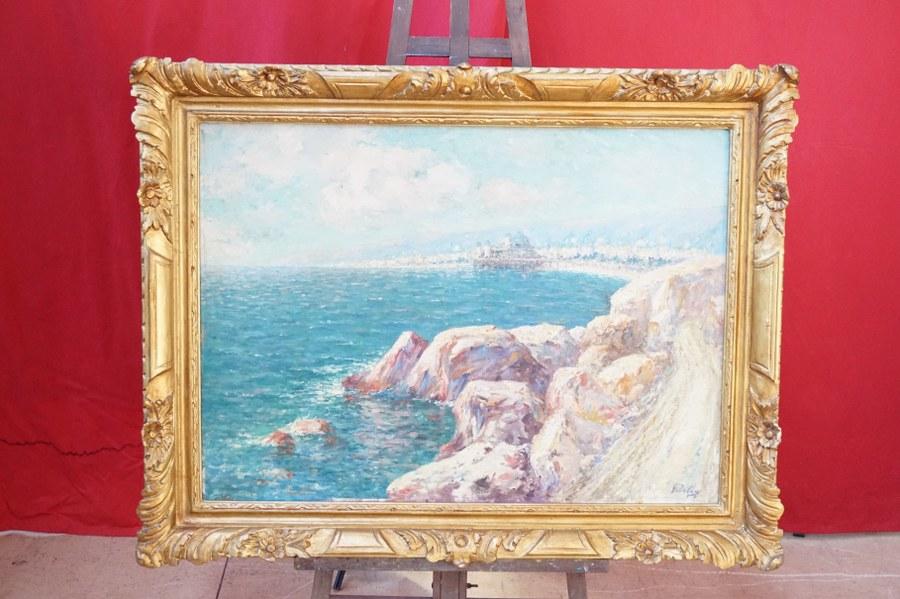 Georges DELOYE (1856-1930). Bord de mer avec vue de paquebot . Huile sur toile signée en bas à droite. Cadre : 92 x 120 cm.