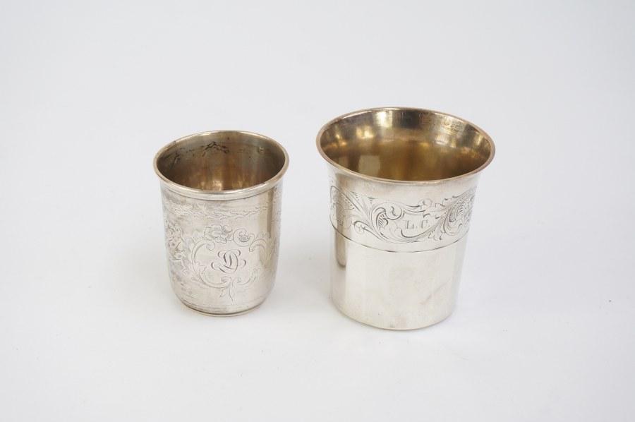 Lot de deux timbales en argent 950°°° Minerve 1er titre, l'un chiffré L.C. inscrit ''offert par son fils le 1er janvier 1844'', l'autre chiffré L.D. Poids : 191 gr.