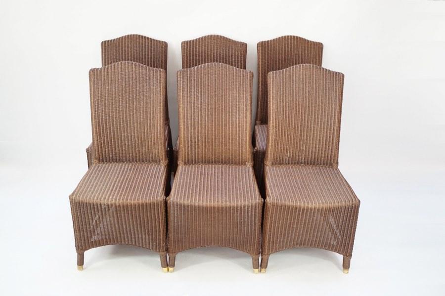 Vincent SHEPPARD (XXE-XXIe). Salon composé de six chaises en rotin et sabot de métal.