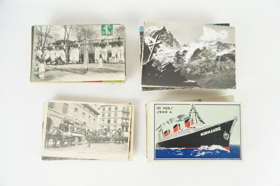 Lot d'environ 250 cartes postales sur les débuts de l'aviation, le cyclisme, le sport, la montagne, les gares et trains, les paquebots. XIXe-XXe siècle.