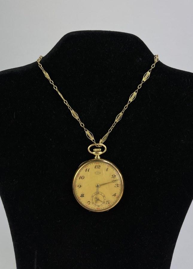 Montre Gousset en or jaune (750°°°) de marque TAXI. Chronomètre à 6h. Poids brut : 54,4 gr.  Avec sa chaîne en fix.