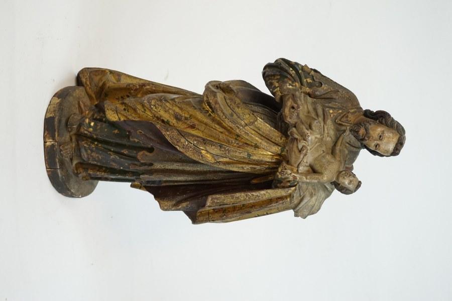 Saint Joseph et l'Enfant Jésus en bois sculpté en ronde-bosse.