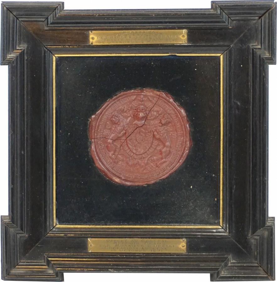 Empreinte de sceau en cire rouge de Charles Ier de Bourgogne, dit Charles le Téméraire, avec au centre un écu , écartelé.