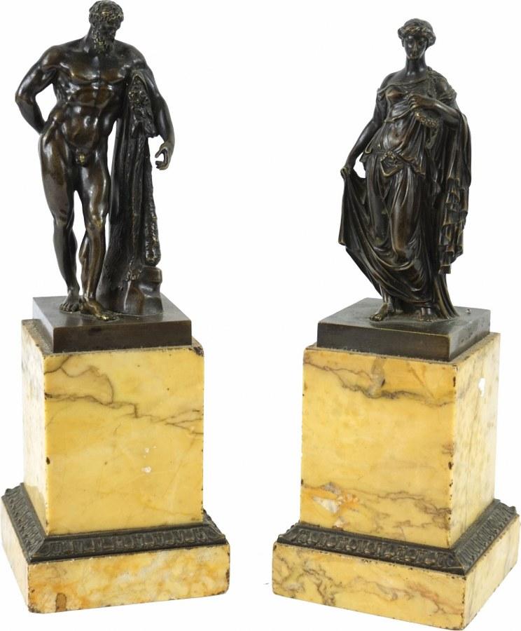 Paire de sujets en  bronze patiné représentant l'Hercule Farnèse et la Flore Farnèse.